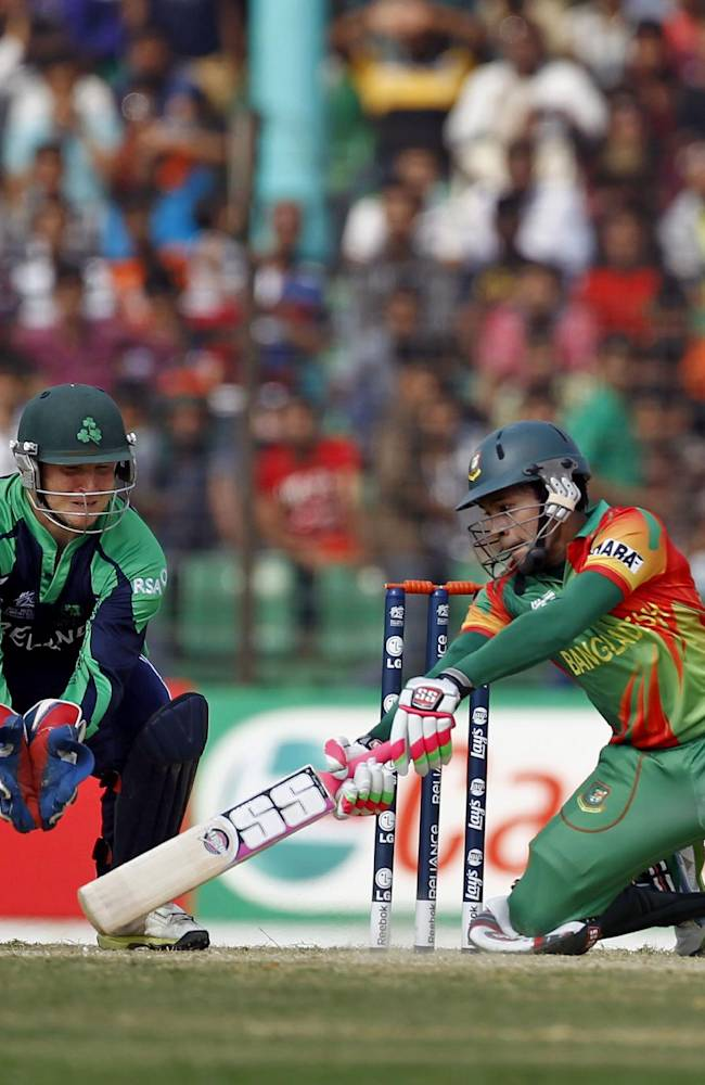Bangladesh's Mushfiqur Rahim, right, plays a shot in front of Ireland's wicketkeeper Gary Wilson during a warm up cricket match between them ahead of the ICC World Twenty20 Cricket tournament in Fatullah, near Dhaka, Bangladesh, Friday, March 14, 2014