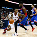 ATLANTA, GA - DECEMBER 10: Jeff Teague #0 of the Atlanta Hawks drives against Nerlens Noel #4 and Michael Carter-Williams #1 of the Philadelphia 76ers at Philips Arena on December 10, 2014 in Atlanta, Georgia. (Photo by Kevin C. Cox/Getty Images)
