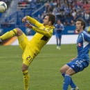 Columbus Crew's Chad Barson, left, kicks the ball back over the head of Montreal Impact Jeb Brovsky right, during the second half of a soccer game in Montreal on Saturday, Sept. 14, 2013. (AP Photo/The Canadian Press, Peter McCabe)