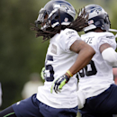 Seattle Seahawks cornerbacks Richard Sherman, left, and Akeem Auguste leap back-to-back as they celebrate a defensive play at an NFL football camp practice Friday, July 25, 2014, in Renton, Wash. (AP Photo) The Associated Press