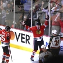 Chicago Blackhawks left wing Bryan Bickell turns to teammate Chicago Blackhawks left wing Viktor Stalberg after scoring the w