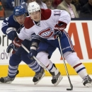 FILE - In this Saturday April 27, 2013 file photo, Montreal Canadiens right winger Brendan Gallagher, right, and Toronto Mapl