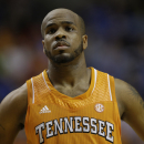 Tennessee guard Trae Golden (11) reacts after the second half of an NCAA college basketball game against Alabama at the Southeastern Conference tournament, Friday, March 15, 2013, in Nashville, Tenn. Alabama won 58-48. (AP Photo/Dave Martin)