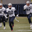 New England Patriots wide receiver Danny Amendola (80), tight ends Rob Gronkowski (87) and D.J. Williams (86) run during a drills and stretching session before practice begins at the NFL football team's facility in Foxborough, Mass., Wednesday, Dec. 4, 20