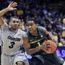 Oregon's Dominic Artis, right, drives against Colorado's Xavier Talton during the first half of an NCAA college basketball game in Boulder, Colo., Thursday, March 7, 2013. (AP Photo/Brennan Linsley)