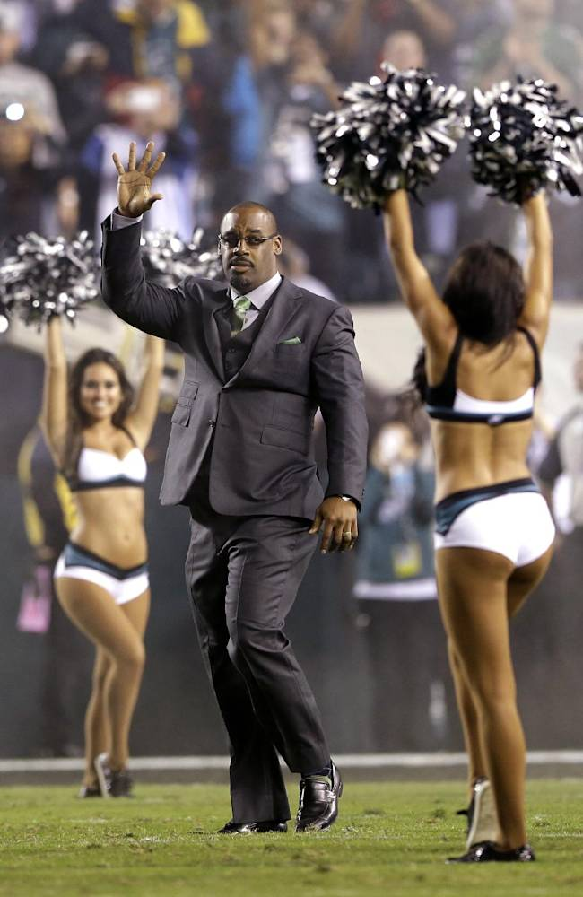Former Philadelphia Eagles quarterback Donovan McNabb waves during halftime of an NFL football game between the Eagles and the Kansas City Chiefs, Thursday, Sept. 19, 2013, in Philadelphia. McNabb's jersey number was retired