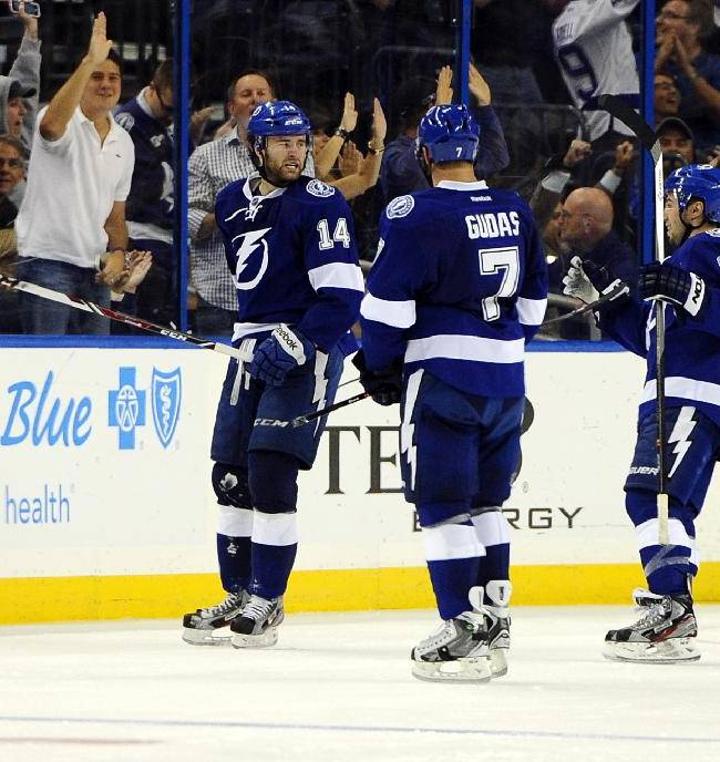 Tampa Bay Lightning right wing Brett Connolly, left, celebrates his goal with teammates, defenseman Radko Gudas, center, of the Czech Republic, and center Tyler Johnson during the third period of an NHL hockey game against the St. Louis Blues, Saturday, Nov. 2, 2013, in Tampa, Fla. Tampa Bay won 4-2