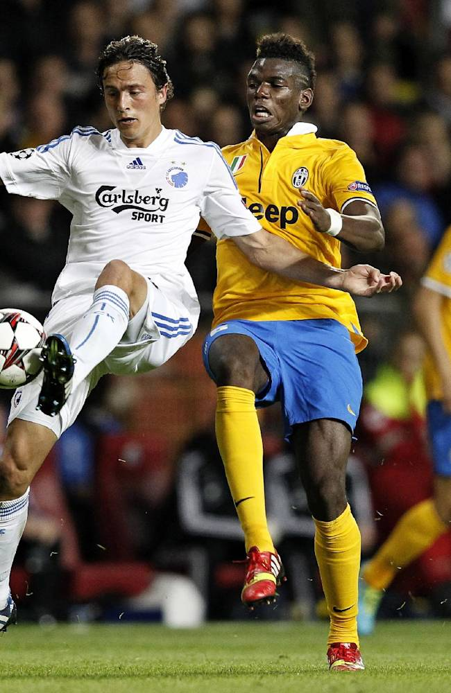 Juventus' Paul Pogba of France and FC Copenhagen's Thomas Delaney, vie for the ball,  during their Champions League Group B soccer match at Parken Stadium, Copenhagen, Denmark, Tuesday Sep. 17, 2013