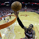 Portland Trail Blazers' LaMarcus Aldridge (12) goes up for a shot against the Houston Rockets during the second half in Game 1 of an opening-round NBA basketball playoff series Sunday, April 20, 2014, in Houston. The Trail Blazers won 122-120 in overtime