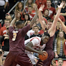 Louisville's Montrezl Harrell, center, looks for help from the defensive pressure of the College of Charleston's Anthony Thomas, left, and Willis Hall during the first half of an NCAA college basketball game, Saturday, Nov. 9, 2013, in Louisville, Ky The