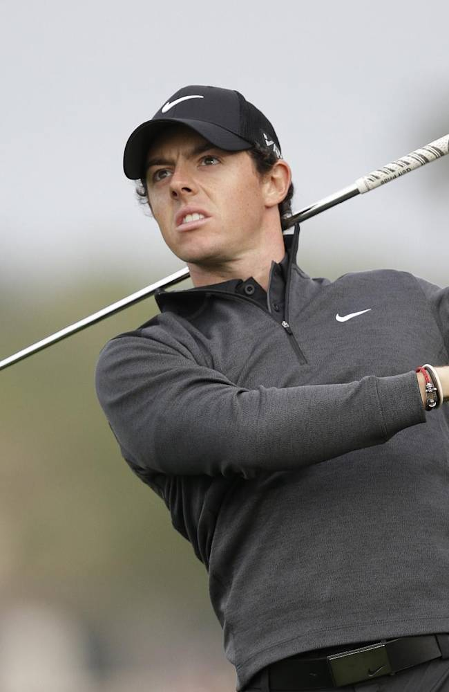 McIlroy soars, Woods struggles at Honda Classic
