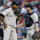 New York Yankees' Ivan Nova talks with catcher Brian McCann in the fifth inning of a baseball game against the Texas Rangers Monday ,July 27, 2015, in Arlington, Texas. (AP Photo/Tony Gutierrez)