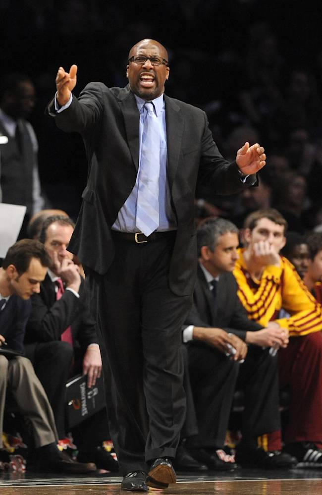Cleveland Cavaliers coach Mike Brown talks to his players during the first half of an NBA basketball game against the Brooklyn Nets on Friday, March 28, 2014, in New York. The Nets won 108-97