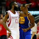 HOUSTON, TX - MAY 25: James Harden #13 of the Houston Rockets celebrates in the fourth quarter as Harrison Barnes #40 of the Golden State Warriors looks on during Game Four of the Western Conference Finals of the 2015 NBA Playoffs at Toyota Center on May 25, 2015 in Houston, Texas. (Photo by Ronald Martinez/Getty Images)
