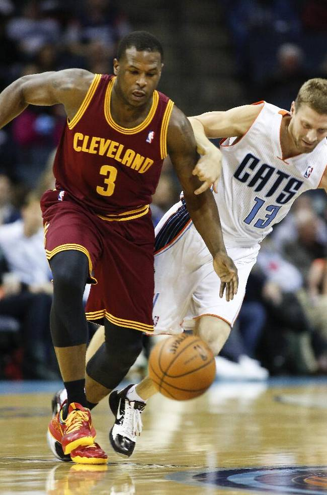 Charlotte Bobcats guard Luke Ridnour, right, fouls Cleveland Cavaliers guard Dion Waiters during the first half of an NBA basketball game in Charlotte, N.C., Friday, March 7, 2014