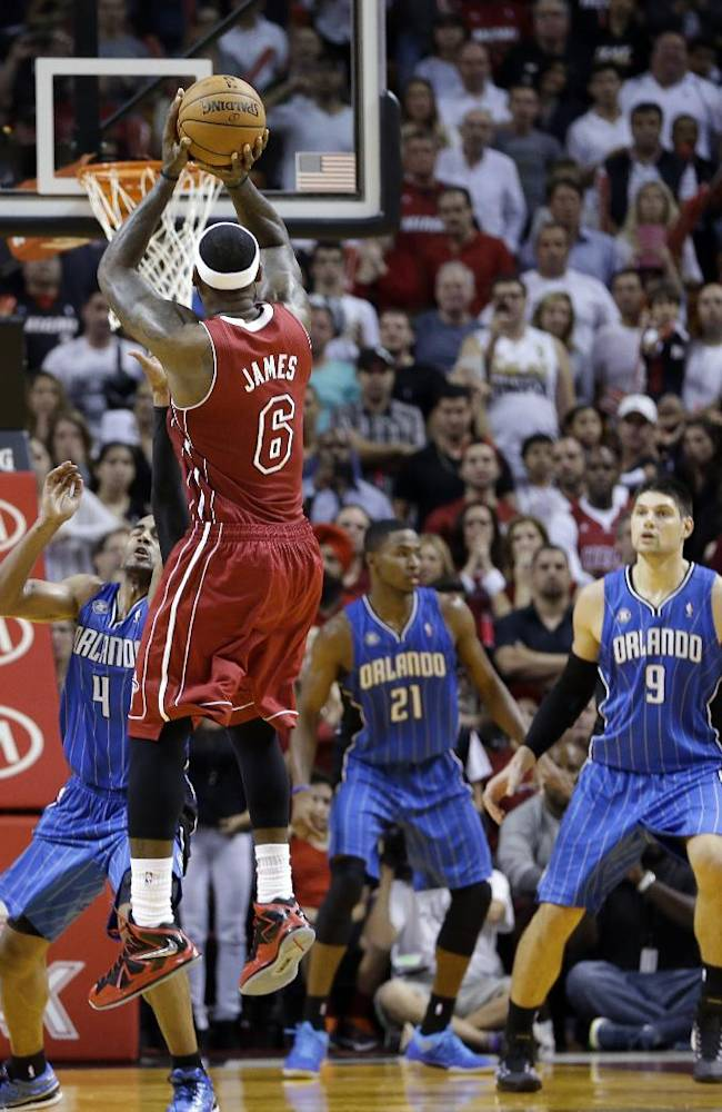 Miami Heat small forward LeBron James (6) prepares to shoot the go-ahead and eventual game-winning basket against the Orlando Magic in the final seconds of the fourth quarter of an NBA basketball game, Saturday, Nov. 23, 2013, in Miami. Miami won 101-99