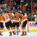 Philadelphia Flyers, from left, Zac Rinaldo,Luke Schenn, Michael Raffl of Austria and Wayne Simmonds celebrate after Schenn's goal during the first period of an NHL hockey game against the Pittsburgh Penguins, Tuesday, Jan. 20, 2015, in Philadelphia The