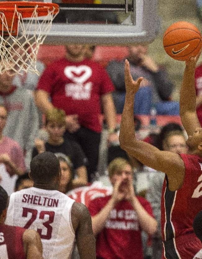 Stanford guard Anthony Brown (21) shoots as Washington State forward D.J. Shelton (23) watches during the second half of an NCAA college basketball game on Saturday, Feb. 15, 2014, in Pullman, Wash. Stanford won 69-56