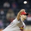 St. Louis Cardinals' Adam Wainwright delivers a pitch during the first inning of a baseball game against the New York Mets Tuesday, April 22, 2014, in New York The Associated Press