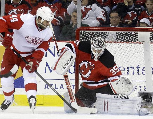 New Jersey Devils goalie Cory Schneider (35) defends against Detroit Red Wings right wing Todd Bertuzzi (44) during the second period of an NHL hockey game Friday, Dec. 6, 2013, in Newark, N.J