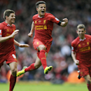 10ThingstoSeeSports - Liverpool's Philippe Coutinho, center, celebrates with teammate Steven Gerrard, left, after he scored the third goal of the game for his side during their English Premier League soccer match against Manchester City at Anfield in Live