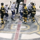 Toronto Maple Leafs and Boston Bruins players shake hands after overtime in Game 7 of their NHL hockey Stanley Cup playoff se