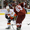 Calgary Flames' Lance Bouma (17) and Phoenix Coyotes' Mike Ribeiro (63) battle for the puck during the first period of an NHL hockey game on Saturday, March 15, 2014, in Glendale, Ariz The Associated Press