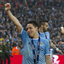 Manchester City's Samir Nasri celebrates after his team's 3-1 win against Sunderland in the English League Cup Final at Wembley Stadium, London, England, Sunday March 2, 2014