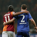 Former Chelsea star, Didier Drogba of Galatasaray, left, and Branislav Ivanovic of Chelsea during their Champions League Round of 16, First Leg match between Galatasaray and Chelsea at Turk Telekom Arena Stadium in Istanbul, Turkey, Wednesday, Feb. 26, 20