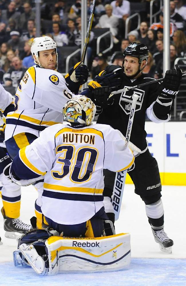 Los Angeles Kings left wing Kyle Clifford, back right, battles Nashville Predators defenseman Shea Weber (6) and goalie Carter Hutton (30) during the second period of their NHL hockey game on Saturday, Nov. 2, 2013, in Los Angeles