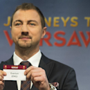 Poland's former soccer player Jerzy Dudek, ambassador for the UEFA Europa League final in Warsaw, shows a ticket with British soccer team Everton during the draw of the round of 32 of the UEFA Europa League 2014/15 at the UEFA Headquarters, in Nyon, Switz