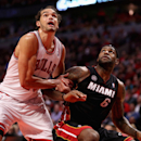 CHICAGO, IL - MAY 10:  Joakim Noah #13 of the Chicago Bulls and LeBron James #6 the Miami Heat battle for rebound position in Game Three of the Eastern Conference Semifinals during the 2013 NBA Playoffs at the United Center on May 10, 2013 in Chicago, Illinois. The Heat defeated the Bulls 104-94. (Photo by Jonathan Daniel/Getty Images)