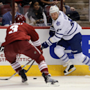 Toronto Maple Leafs center Leo Komarov (47) drives on Arizona Coyotes defenseman Keith Yandle (3) in the first period during an NHL hockey game, Tuesday, Nov. 4, 2014, in Glendale, Ariz The Associated Press