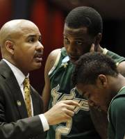 South Florida head coach Stan Heath talks with his players in the first half of an NCAA tournament first-round college basketball game against California, Wednesday, March 14, 2012, in Dayton, Ohio. (AP Photo/Skip Peterson)