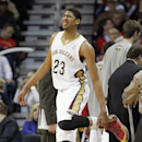 New Orleans Pelicans forward Anthony Davis stretches his leg during a timeout in the second half of an NBA basketball game against the Milwaukee Bucks in New Orleans, Friday, March 7, 2014. The Pelicans defeated the Bucks 112-104 The Associated Press