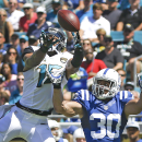 Jacksonville Jaguars wide receiver Allen Robinson (15) can't hang on to a pass as he is defended by Indianapolis Colts free safety LaRon Landry (30) during the first half of an NFL football game in Jacksonville, Fla., Sunday, Sept. 21, 2014 The Associated