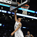 Brooklyn Nets' Deron Williams (8) shoots in front of Orlando Magic's Dewayne Dedmon (3) during the first half of an NBA basketball game Sunday, April 13, 2014, in New York. (AP Photo/Kathy Kmonicek)