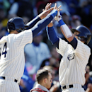 Chicago Cubs first baseman Anthony Rizzo, left, and Justin Ruggiano, right, celebrate after Rizzo scored on Ruggiano's home run during the sixth inning of a baseball game against the Arizona Diamondbacks at Wrigley Field in Chicago on Wednesday, April 23,