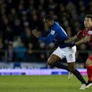 Everton's Sylvain Distin, left, keeps the ball from Queens Park Rangers' Eduardo Vargas during the English Premier League soccer match between Everton and Queens Park Rangers at Goodison Park Stadium, Liverpool, England, Monday Dec. 15, 2014
