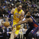 Detroit Pistons forward Greg Monroe, right, knocks the ball away from Los Angeles Lakers center Pau Gasol (16), of Spain, during the first quarter of an NBA basketball game at the Palace in Auburn Hills, Mich., Friday, Nov. 29, 2013 The Associated Press