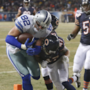 Dallas Cowboys tight end Jason Witten (82) makes a touchdown run against Chicago Bears safeties Chris Conte (47) and Major Wright during the first half of an NFL football game, Monday, Dec. 9, 2013, in Chicago The Associated Press