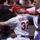 Los Angeles Angels' Josh Hamilton, center, has his helmet taken off by Mike Trout after scoring on a single by Erick Aybar during the second inning of a baseball game against the Oakland Athletics, Sunday, Aug. 31, 2014, in Anaheim, Calif. (AP Photo/Mark J. Terrill)