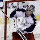 Columbus Blue Jackets goalie Sergei Bobrovsky stops the puck in the third period of a hockey game against the Florida Panthers, Saturday, April 12, 2014, in Sunrise, Fla. The Blue Jackets defeated the Panthers 3-2 The Associated Press