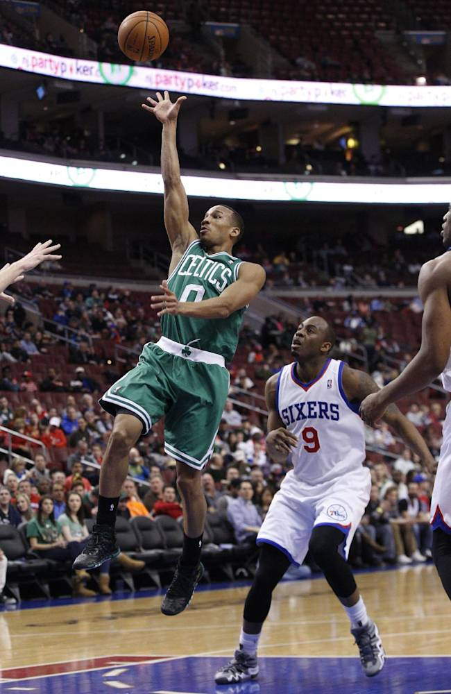 Boston Celtics' Avery Bradley, left, goes up for the shot as he gets past Philadelphia 76ers' James Anderson during the first half of an NBA basketball game, Wednesday, Feb. 5, 2014, in Philadelphia