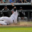 Colorado Rockies' Michael Cuddyer (3) slides into home on a double hit by Carlos Gonzalez (5) during the eighth inning of a baseball game against the Chicago White Sox, Wednesday, April 9, 2014, in Denver. The Rockies won 10-4 The Associated Press
