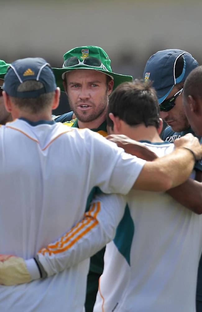 South African one-day international cricket team captain AB de Villiers, center facing camera, speaks to his team members as they huddle before their warm up game against Sri Lanka Board XI in Moratuwa on the outskirts of Colombo, Sri Lanka, Thursday, July 3, 2014