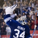 Toronto Maple Leafs goalie James Reimer celebrates after defeating the Los Angeles Kings during a shoot out in NHL hockey action in Toronto on Sunday, Dec. 14, 2014 The Associated Press
