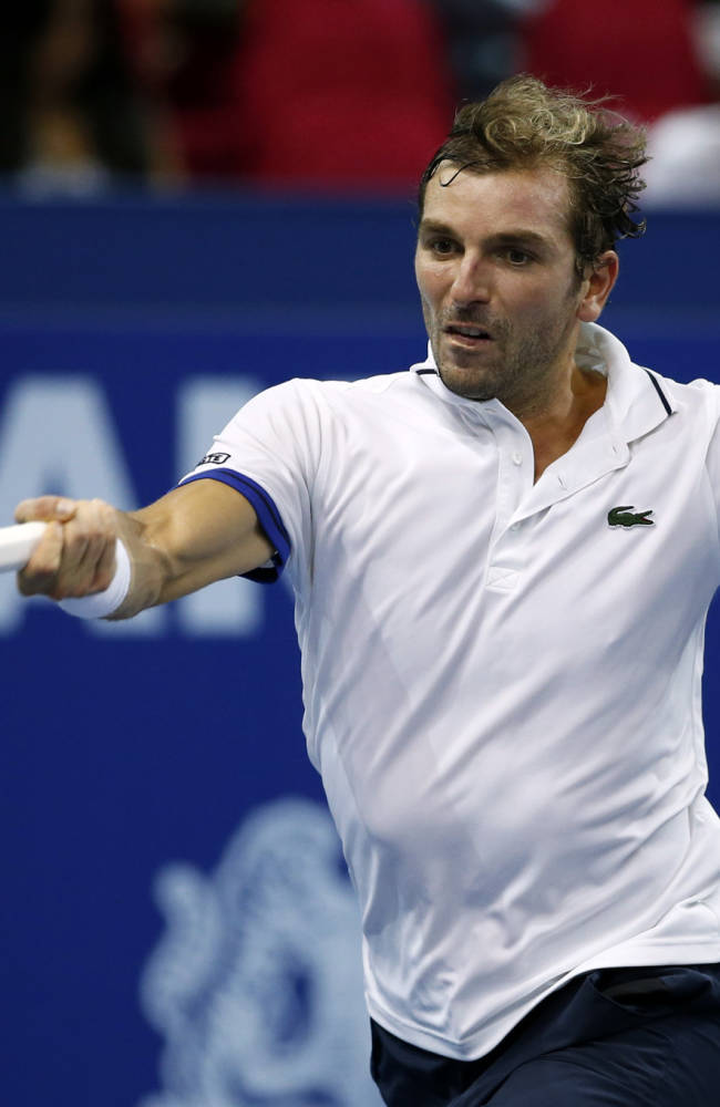 Julien Benneteau of France returns a shot against Joao Sousa of Portugal during their final match at the Malaysian Open tennis tournament in Kuala Lumpur, Malaysia, Sunday, Sept. 29, 2013