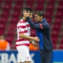 United States' head coach Tab Ramos, right, comforts United States' Miguel Lopez Jr, left, after the Under-20 World Cup Group A soccer match between the U.S. and Spain, in Istanbul, Turkey, Friday, June 21, 2013. The U.S. team lost by 1-4. (AP Photo/Gero Breloer)