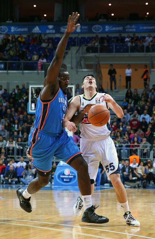 The NBA team Oklahoma City Thunder's Kendrick Perkins defends as Emir Preldzic of  Fenerbahce Ulker tries a basket during a preseason basketball game in Istanbul, Turkey, Saturday, Oct. 5, 2013. Oklahoma City Thunder has opened the preseason schedule with a game against the five-time Turkish champions at the Ulker Sports Arena.(AP Photo)